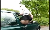 Sexy chick peeing from the car window