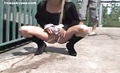 Beautiful blonde babe peeing in public