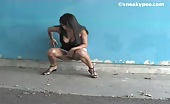 Beautiful college teen peeing outdoor