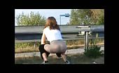 Tattooed girl pooping outdoor