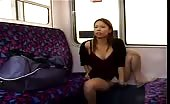 Pierced Asian peeing in train