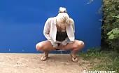Blonde milf peeing behind dumpsters