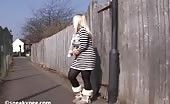Sexy blonde babe peeing on the alley