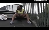 Ebony girl peeing in a public place