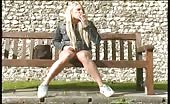 Blonde slut peeing on public bench
