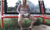 Drunk blonde model peeing outdoor