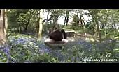 Teen peeing in blue flowers