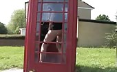 Hot teen peeing in a phonebooth