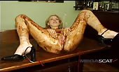 Horny blonde covered her body with poop
