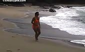 Sexy babe peeing at the beach