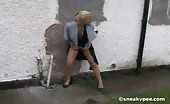 Little blonde peeing outdoor