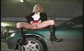 Blonde girl peeing in parking lot