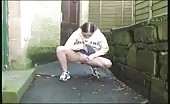Young girl peeing outdoor