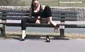 Busty brunette peeing on wooden bench