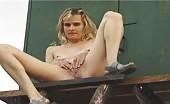 Blonde slim girl peeing outdoor