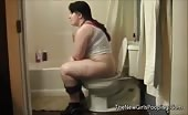 Dark haired babe shitting in toilet