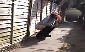 Teen redhead peeing in an alley