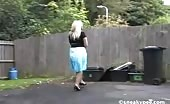 Busty blonde peeing on wooden bench
