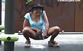 Busty brunette peeing outdoor