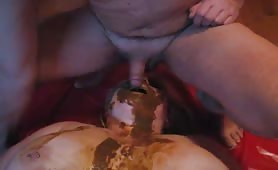 Busty wife rubbing brown poop on her face