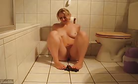 Beautiful blonde smearing crap on her feet