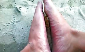Sand and poop on his sexy feet