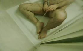 Mature man doing enema to himself