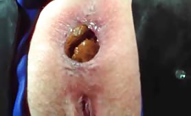 Hot female takes a long shit in close up