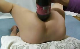 Champagne bottle in her tight asshole