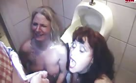 Two hot milfs drinking piss from a lucky guy