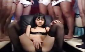 Petite Japanese sitting naked in a scat orgy