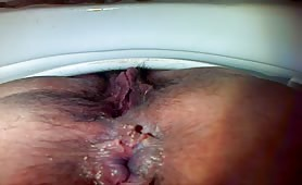 Shaved wife pooping a yellow turd in reverse position