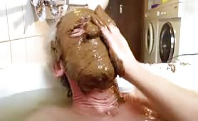 Old man rubbing poop on his entire face