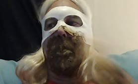 Blonde shemale smearing crap on her entire face