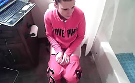 Sexy teen undressed to take a shit in the toilet