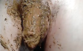 Erect cock with brown poop