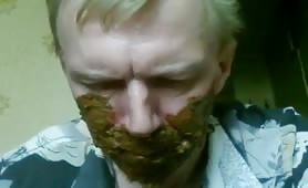 Slave eating and smearing poop on his face