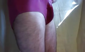 Hairy man pooping in pink panties