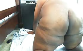 Fat black guy shitting while storking his small cock