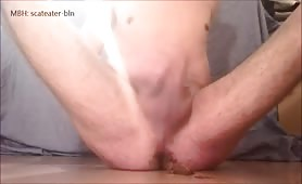 Jerking off with liquid shit on his cock until he cums