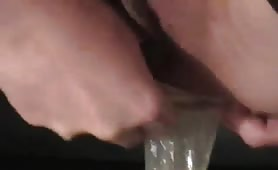 Sexy MILF masturbating with a scat condom