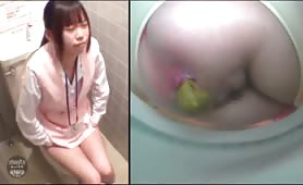 Brunette young girl using a public bathroom