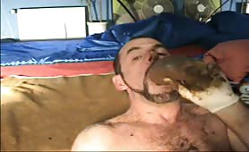 Sucking a very long turd while jerking off