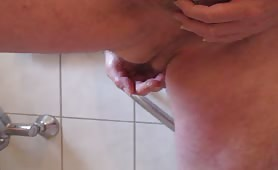 Rubbing a turd on his medium cock