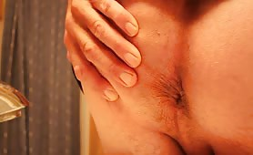 High quality video of a mature man shitting in close up
