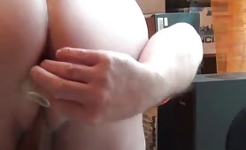 Dildo insertion into his tight butthole