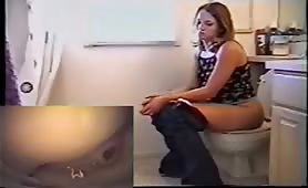 Blonde teen pooping in hte toilet