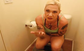 Tattooed rocker girl pooping