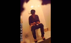 Sexy lady shitting in a public bathroom