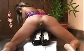 Horny MILF pooping in black high heels
